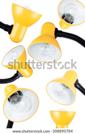A lot of fun yellow table lamps on a white background - stock photo