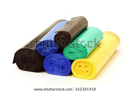 A lot of garbage bags rolls on a white background - stock photo