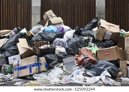 a lot of garbage in the street - stock photo