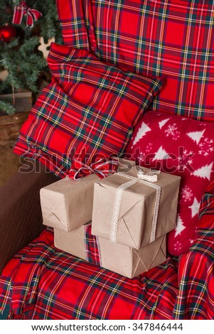 a lot of gifts on armchair, plaid and Christmas tree