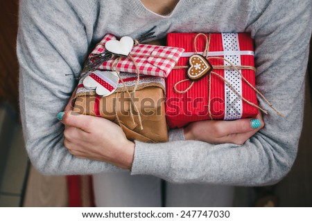 A lot of gifts on Valentine's Day in the hands of a girl - stock photo