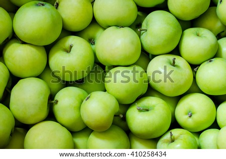 a lot of green apples as a background - stock photo
