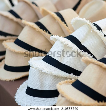 A lot of hats lie on the table - stock photo