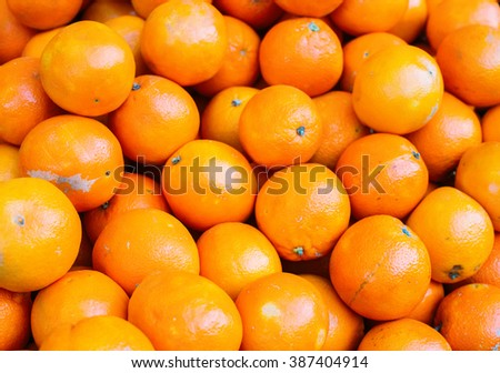 A lot of juicy mandarin oranges. Bunch of fruits. Vivid colours. Shallow focus.  - stock photo