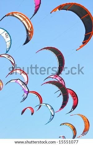 A lot of kiteboarding kites in the sky - stock photo