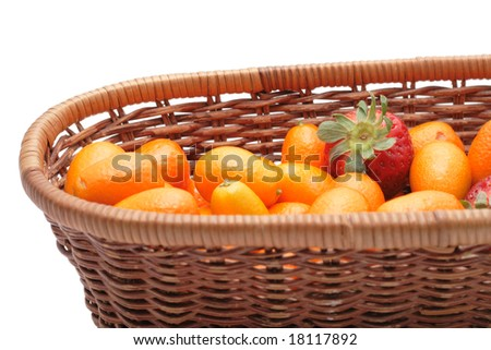 A lot of kumquats an strawberry isolated on the white background - stock photo