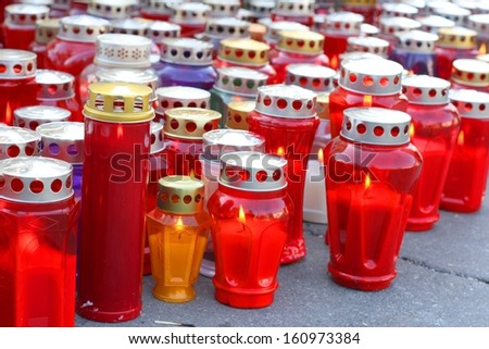 A lot of lit candles for All Saints Day, a Holy Day of Obligation  - stock photo