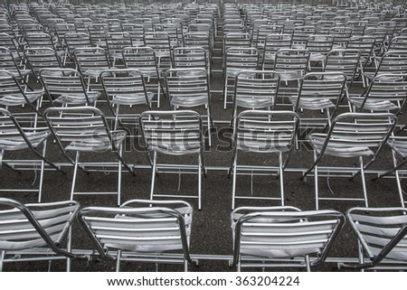 a lot of metal chairs without people - stock photo