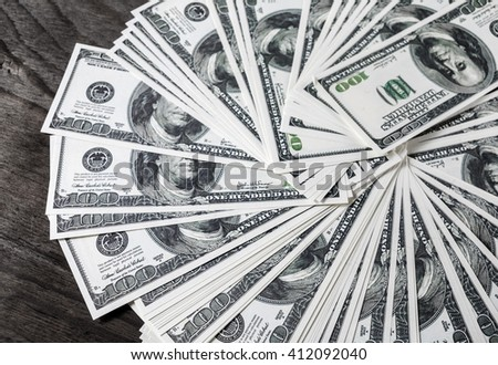 A lot of money. Money background. Pile of dollars. One Many one hundred dollar bills. Fake money. Business concept. - stock photo