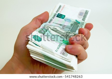 A lot of money Russian rubles in a hand.
