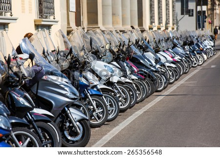 a lot of motor scooters parked  - stock photo