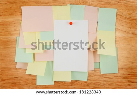 A lot of note papers on wooden house wall - stock photo