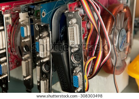 A lot of old dusty computer graphics cards - stock photo