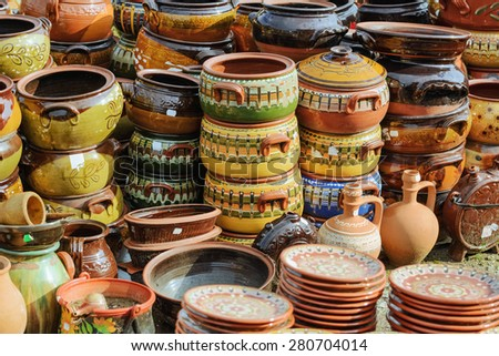 A Lot of Old Earthenware Crockery on the Pottery Market - stock photo