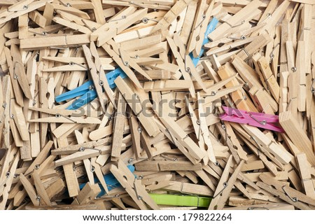 a lot of old fashioned wooden clothes pins