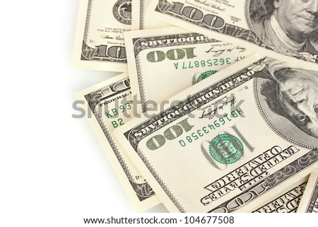 A lot of one hundred dollar bills isolated on white