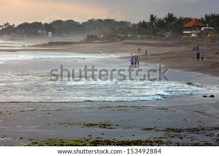 A lot of people along the beach Bali. Indonesia - stock photo