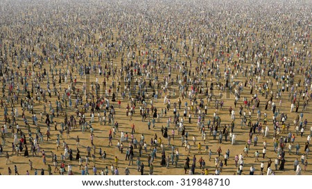 a lot of people going through the desert - stock photo