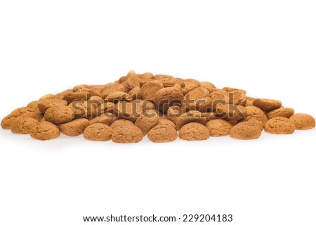 A lot of pepernoten, traditional dutch treat for Sinterklaas event on 5 December. Isolated on white background. Front view.