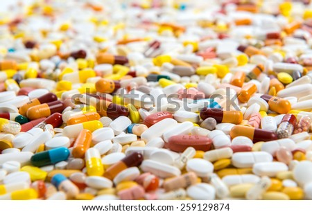 a lot of pills in defferent colors - stock photo