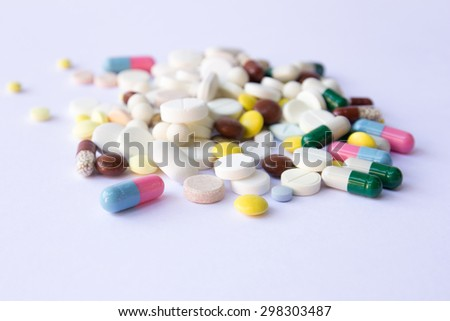 A lot of pills on the white background. Medicine