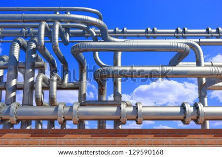 A lot of pipes  on a background sky - stock photo