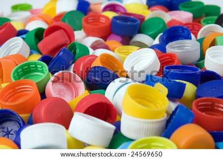 a lot of plastic bottle caps - stock photo