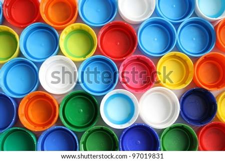a lot of plastic bottle caps - stock photo