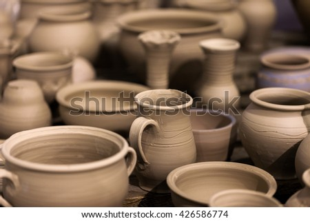 a lot of pottery on the table - stock photo