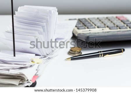 A lot of receipts on accountant desk - stock photo