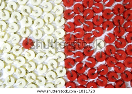 a lot of red and white size washers - stock photo