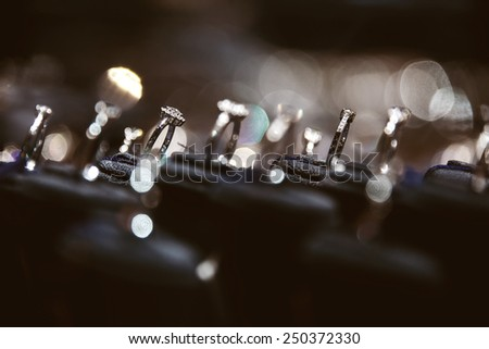 A lot of rings in jewelry window display - stock photo