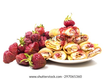 a lot of ripe strawberries with curd pancakes - stock photo