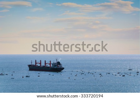A lot of Small Boats around of Bulk Carrier  - stock photo