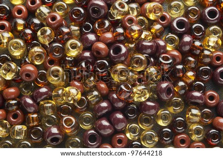 a  lot of small brown  beads on plane - stock photo