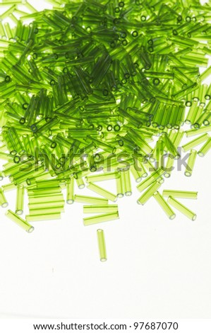 a  lot of small green spangles on plane - stock photo