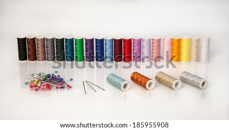 A lot of Threads with needles and pins