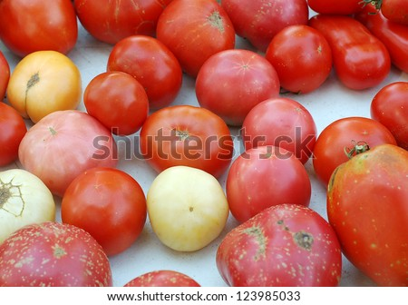 a lot of tomatoes in market place