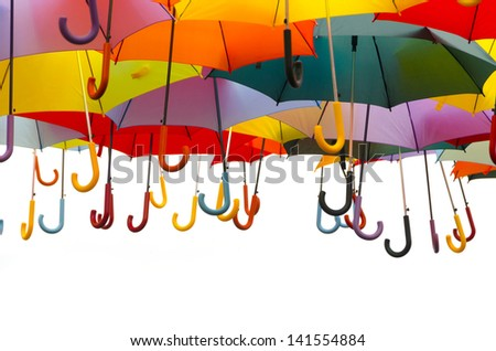 A lot of umbrellas in diverse colors isolated over a white background - stock photo