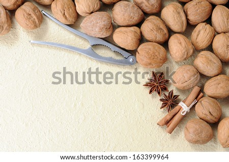 a lot of walnut, star anise and cinnamon  on table - stock photo