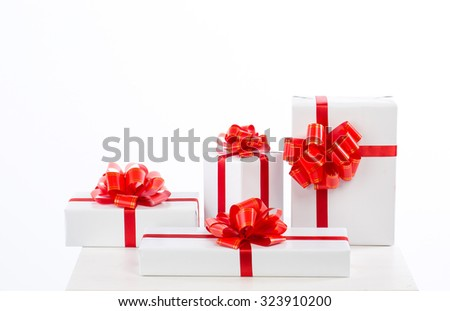 A lot of white gift box with red ribbon bow, isolated on white.