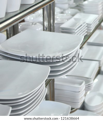 a lot of white plates in a shop - stock photo