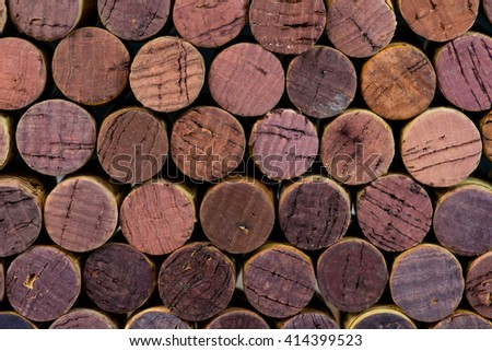 a lot of wine corks with violet and purple stains