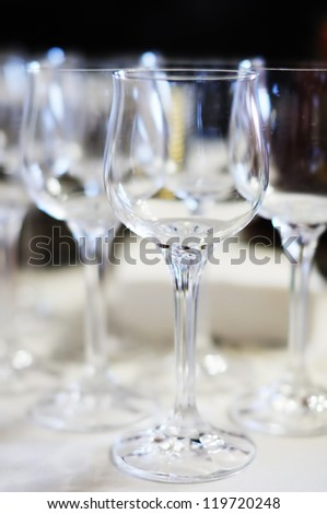 A lot of wine glasses in a row - stock photo