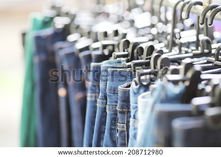a lot of womens jeans at a store - stock photo