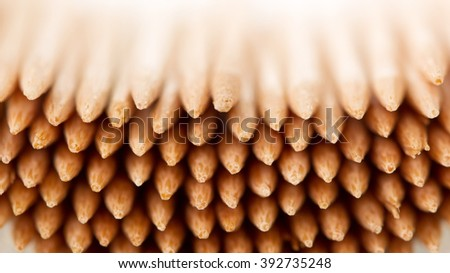 A lot of wooden toothpicks close up. Texture. - stock photo