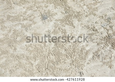 A lots of small crab burrows and sand balls abstract background - stock photo