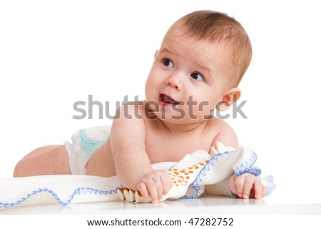 a loughing baby is wearing fresh diapers