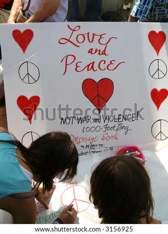 A love and peace poster that everyone is invited to sign at an anti-war protest on Hollywood Boulevard on March 17, 2007. - stock photo