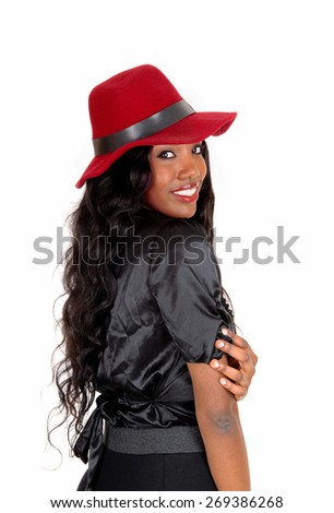 A lovely African American woman in a black blouse and long black curly